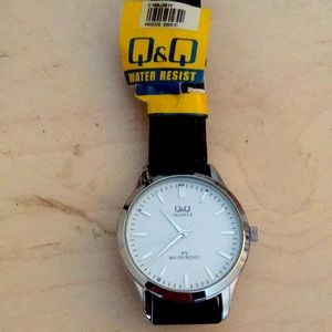 Q&Q white face & black leather watch